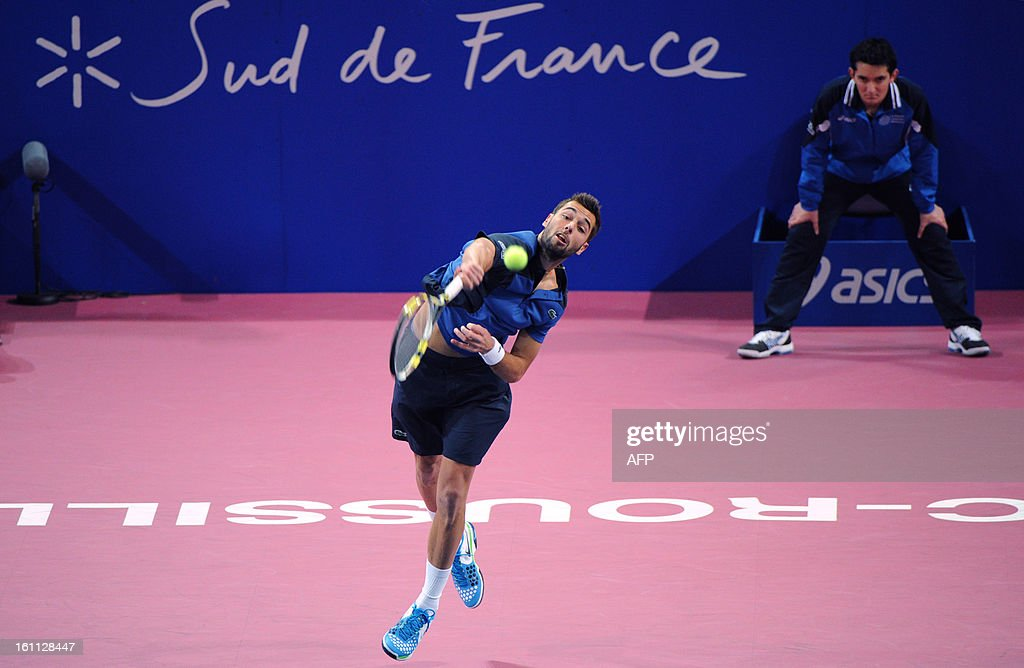 French Benoit Paire returns the ball to his opponent French Michael Llodra during the Open Sud de France world tour ATP Series semi final tennis match, on February 9, 2013 in Montpellier, southern France. Paire won 4-6, 6-3, 6-1. AFP PHOTO / SYLVAIN THOMAS