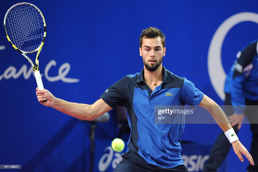 French Benoit Paire returns the ball to his opponent French Michael Llodra during the Open Sud de France world tour ATP Series semi final tennis match, on February 9, 2013 in Montpellier, southern France. Paire won 4-6, 6-3, 6-1.