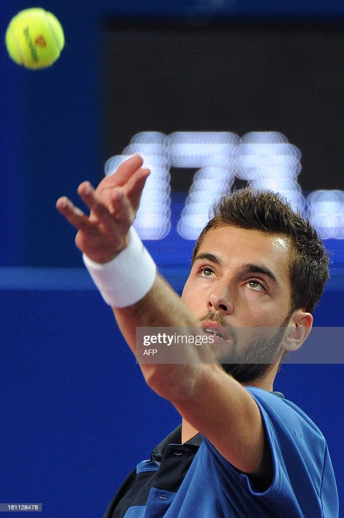 French Benoit Paire serves to his opponent French Michael Llodra during the Open Sud de France world tour ATP Series semi final tennis match, on February 9, 2013 in Montpellier, southern France. Paire won 4-6, 6-3, 6-1.