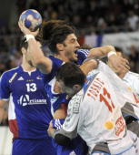 French Bertrand Gille tries to score against Serbian Alem Toskic during their handball friendly match France vs Serbia on January 10 2010 at the...