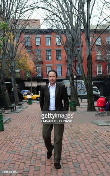 French best selling author Marc Levy browses poses during a photo session in New York's West Village the neighborhood where he lives November 24 2009...