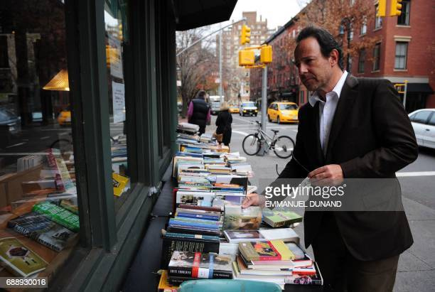 French best selling author Marc Levy browses through books during a photo session in New York's West Village the neighborhood where he lives November...