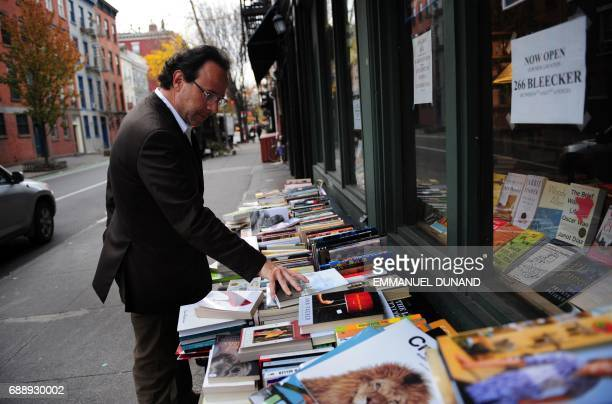 French best selling author Marc Levy browses through nooks during a photo session in New York's West Village the neighborhood where he lives November...