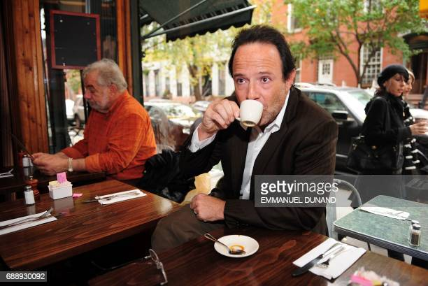 French best selling author Marc Levy drinks a coffee during a photo session in 'Tartine' a cafe in New York's West Village the neighborhood where he...