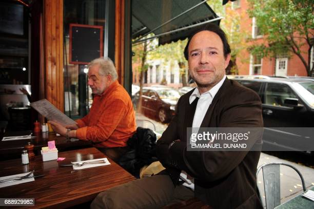 French best selling author Marc Levy poses during a photo session in at 'Tartine' a cafe in New York's West Village the neighborhood where he lives...