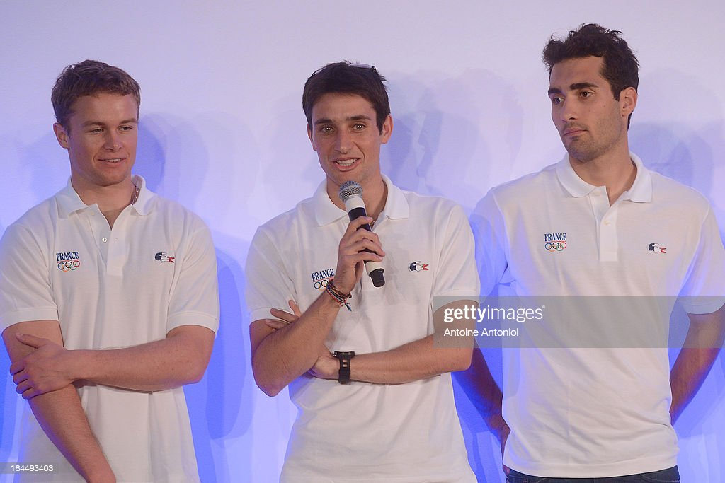 French biathlon champions Martin Fourcade (R) and Florent claude (L) listen to nordic combined ski champion Jason Lamy Chappuis before being chosen as his countries flag bearer for the Sochi 2014 Winter Olympics on October 14, 2013 in Paris, France.