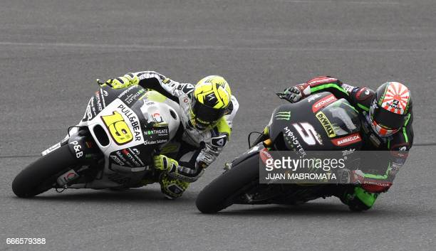 French biker Johann Zarco rides his Yamaha next to Spanish Alvaro Bautista on Ducati during the MotoGP race of the Argentina Grand Prix at Termas de...