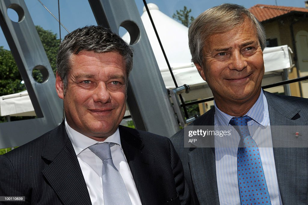French billionaire Vincent Bollore (R) poses with Italina car maker Pininfarina President Paolo Pininfarina during the 80th anniversary celebrations of Pininfarina group in Cambiano near Turin on May 21, 2010.