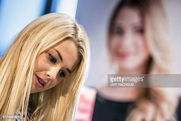 French blogger Marie Lopez aka EnjoyPhoenix signs her first book 'Enjoy Marie' on June 17 2015 in a cultural store in Lyon AFP PHOTO / JEFF PACHOUD