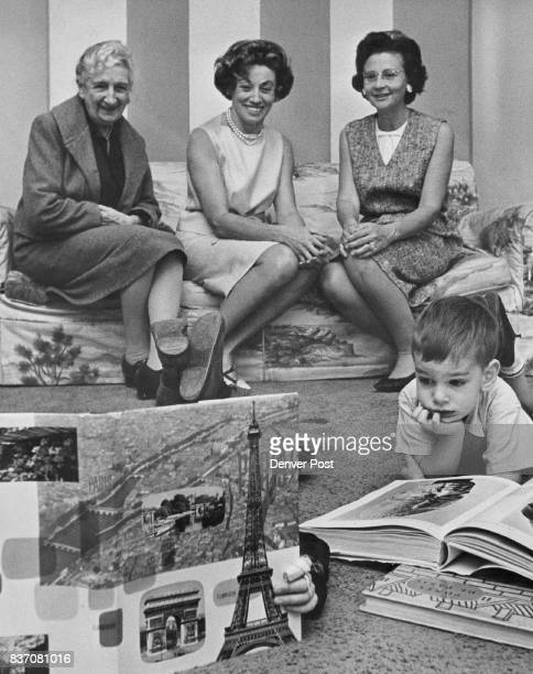 French Book's Over His Head Those upturned feet belong to Benoit Trufanow son of French vice consul and Mme Georges Trufanow She is at right on couch...