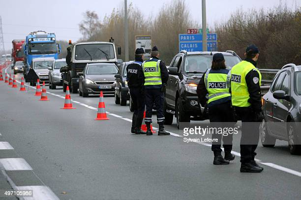 French border and customs police control vehicles at the FranceBelgium border at Baisieux near Lille in Northern France as a state of emergency is...