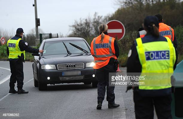 French border and customs police control vehicles on November 14 2015 at the FranceBelgium border at Saint Aybert following several attacks in Paris...