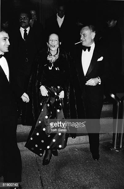 French born fashion editor Diana Vreeland and American fashion designer Bill Blass with a cigarette in his mouth leave after the opening gala for of...
