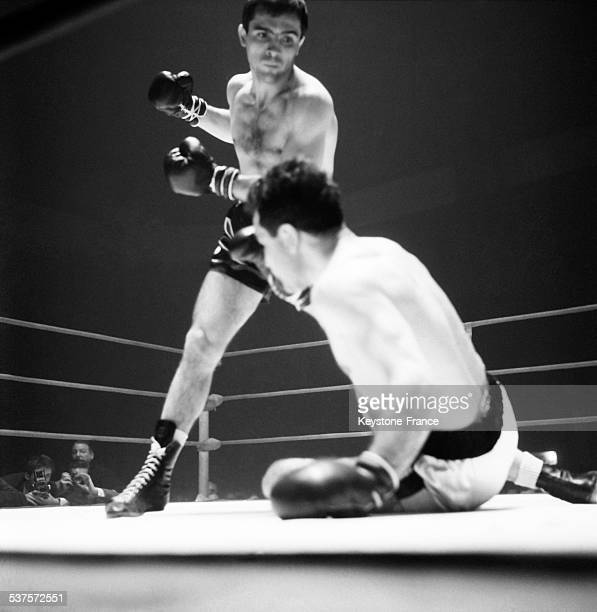 French boxer Marcel Cerdan has beaten Di Martino by judgment of the arbitrator in the third round at the Sports Palace on April 27 1965 in Paris...