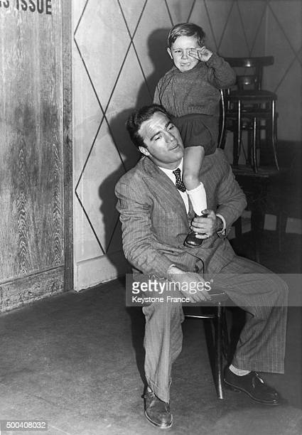French boxer Marcel Cerdan with one of his sons Marcel Junior on February 25 1947