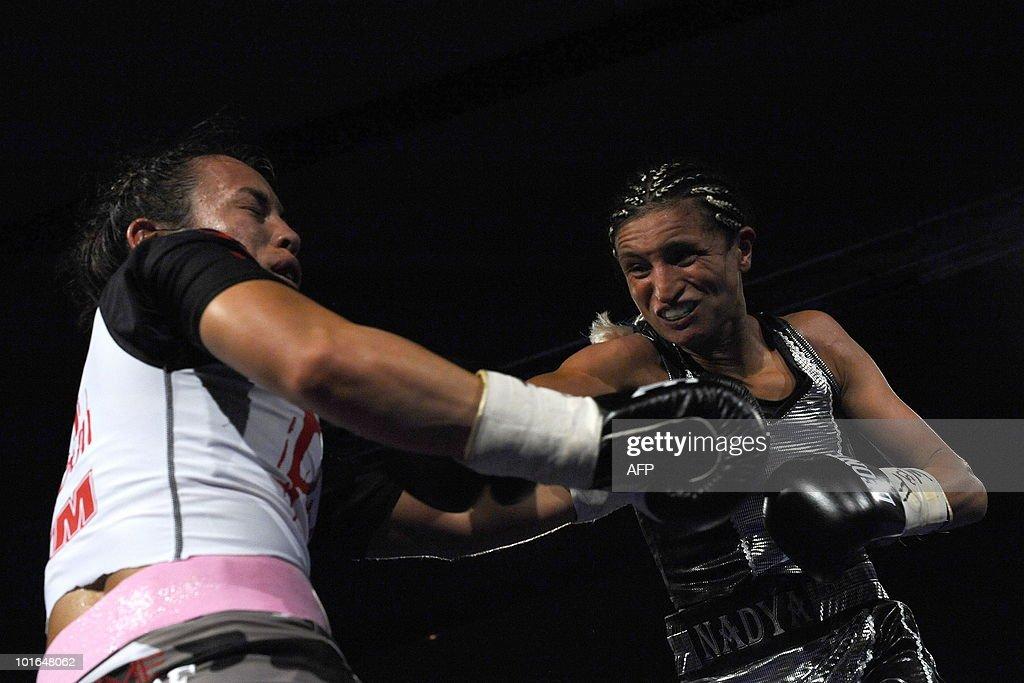 French boxer Nadya Hokmi (R) fights against US boxer Elena Reid during the World Boxing Foundation (WBF) super flyweight championship match on June 5, 2010 in Lingolsheim, eastern France. Hokmi won.