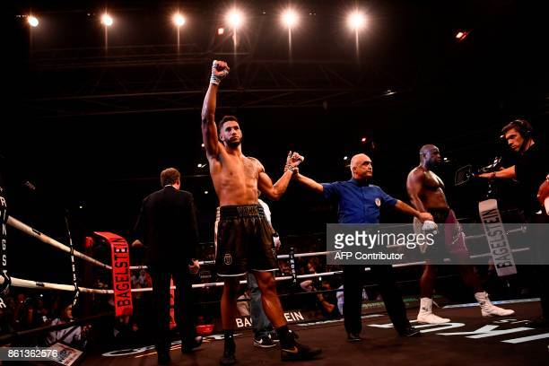 TOPSHOT French boxer Tony Yoka celebrates after winning his second professional fight against US Jonathan Rice at the Zenith in Paris on October 14...