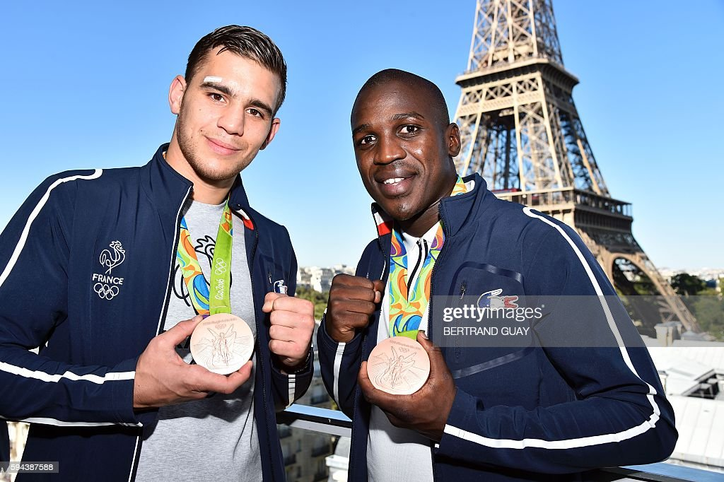 French boxers Mathieu Bauderlique and Souleymane Cissokho pose with their bronze medal on August 23 in front of the Eiffel tower in Paris France's...