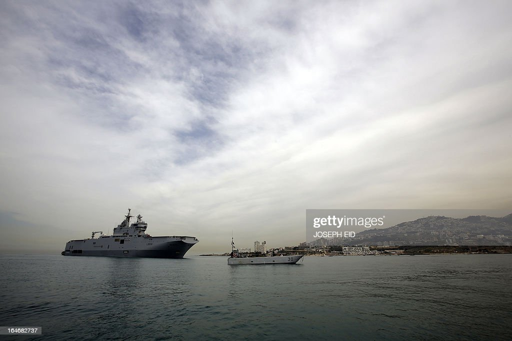 A French BPC Tonnerre assault helicopter carrier is seen in the bay of Jounieh, north of Beirut, after Lebanese and French military took part in sea and land war games on March 26, 2013.