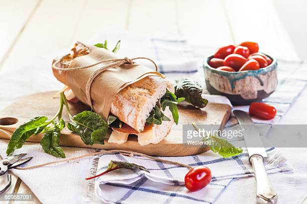 French bread with Jamon serrano, cheese, tomatoes and lettuce