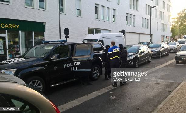 French BRI police unit officers stand in front of the 'Les Closbilles' student residence in Cergy Val d'Oise department northwest of Paris on June 6...