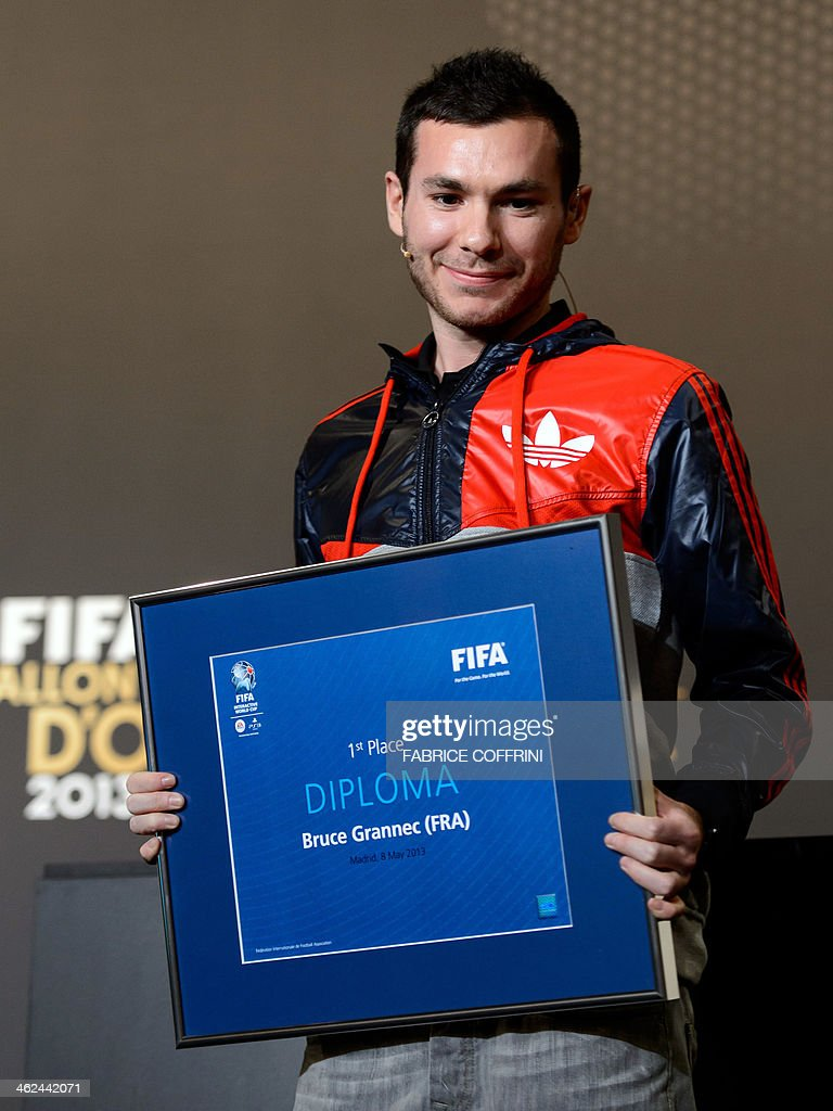 French Bruce The Machine Grannec poses with his diploma after being crowned FIFA Interactive World Cup 2013 champion ahead of the FIFA Ballon d'Or award ceremony at the Kongresshaus in Zurich on January 13, 2014.