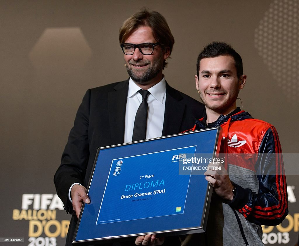 French Bruce The Machine Grannec poses with his diploma with Borussia Dortmund's German coach Jurgen Klopp (L) after being crowned FIFA Interactive World Cup 2013 champion ahead of the FIFA Ballon d'Or award ceremony at the Kongresshaus in Zurich on January 13, 2014. AFP PHOTO / FABRICE COFFRINI