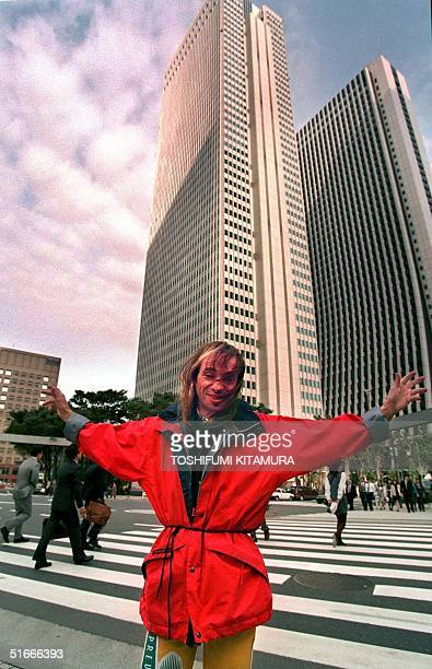 French building climber Alain Robert opens his arms in front of the Shinjuku Nomura building after police stopped him from climbing the 210 metretall...