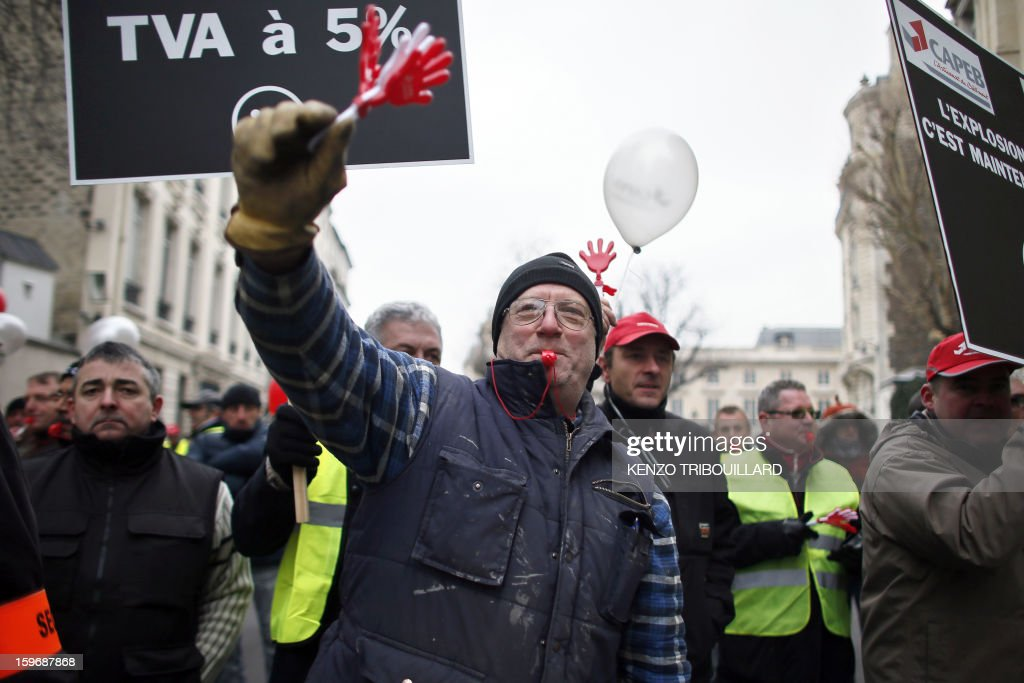 French building craftsmen take part in a demonstration near the French National Assembly in Paris on January 18, 2013.