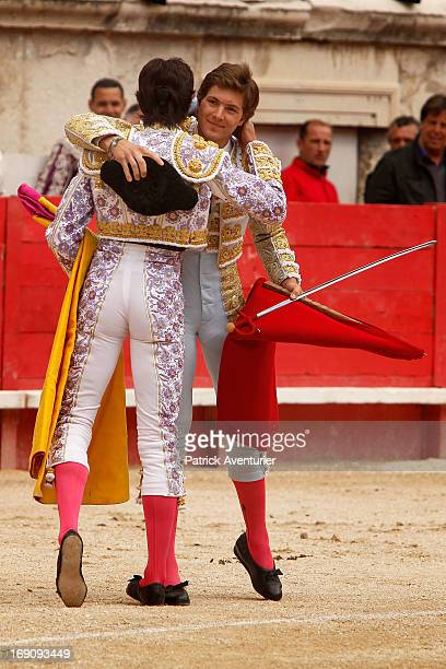 French bullfighters Juan Leal and Sebastien Castella embrace in the Nimes Arena during the 61st annual Pentecost Feria de Feira on May 19 2013 in...