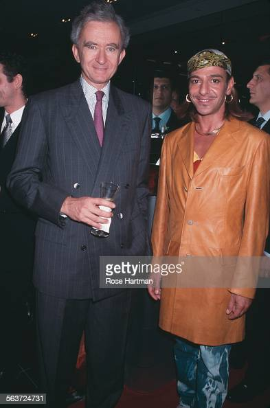 French business magnate and Chief Executive Officer of LVMH Bernard Arnault and British fashion designer John Galliano attend the Sephora store...