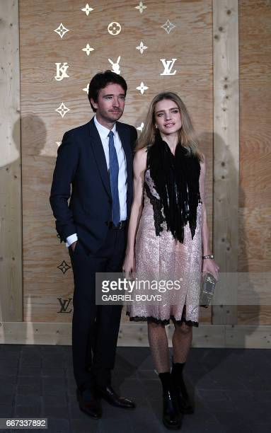 French businessman Antoine Arnault and his wife Russian model Natalia Vodianova pose during a photocall ahead of a diner for the launch of a Louis...