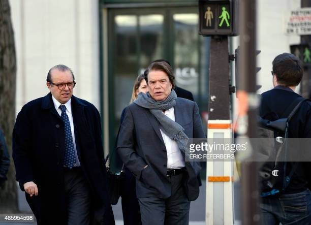 French businessman Bernard Tapie flanked by his lawyer Herve Temime arrives for a hearing at the financial pole on March 12 2015 The Paris Court of...