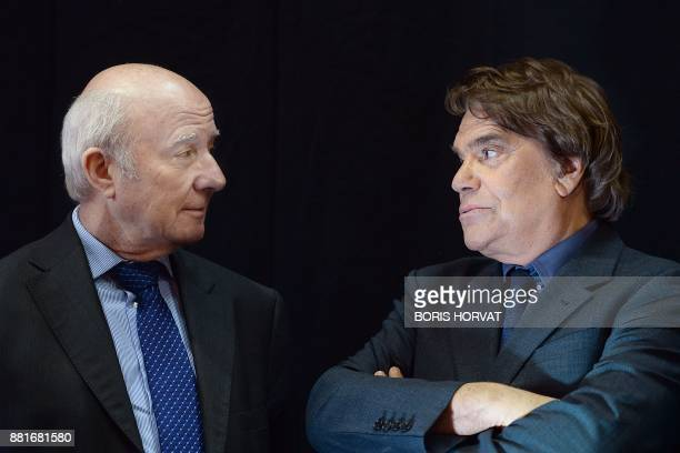 French businessman Bernard Tapie owner of the French newspaper La Provence speaks with La Provence's news editor Olivier Mazerolle as they attend the...