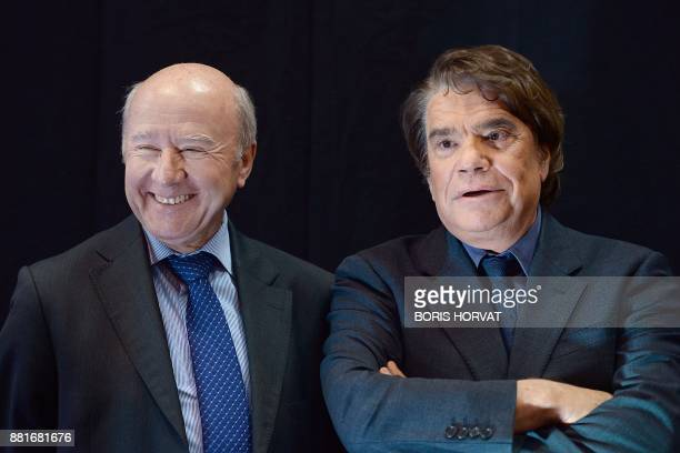 French businessman Bernard Tapie owner of the French newspaper La Provence stands next to La Provence's news editor Olivier Mazerolle as they attend...