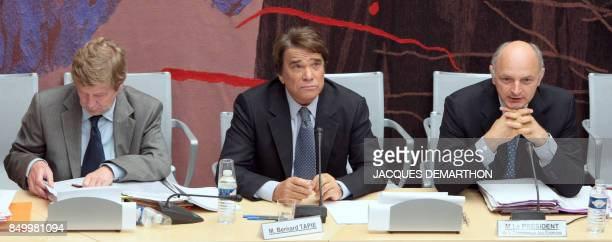 French businessman Bernard Tapie speaks next to his lawyer Maurice Lantourne and the head of the French National Assembly Financial Commission MP...