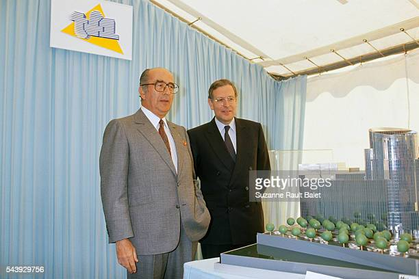 French businessman Francis Bouygues and journalist and President of TF1 Patrick Le Lay look at a model of the new TF1 headquarters in...
