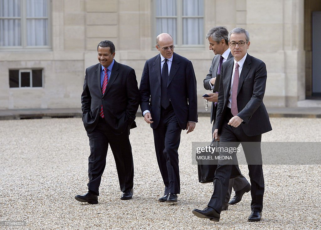 French businessman Jean-Pierre Clamadieu (R), Chairman of the Board and Chief Executive Officer of Rhodia, a French chemical company acquired and integrated into the Belgian group Solvay, arrives at the Elysee Palace for a dinner organized with the World Economic Forum in Davos and French President at the Elysee Palace in Paris on June 25, 2013.