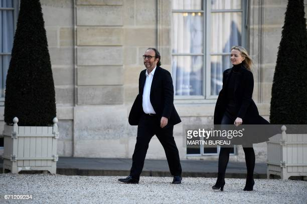 French businessman Xavier Niel and his wife Delphine Arnault arrive at the Elysee Palace in Paris for a reception for Microsoft cofounder Bill and...