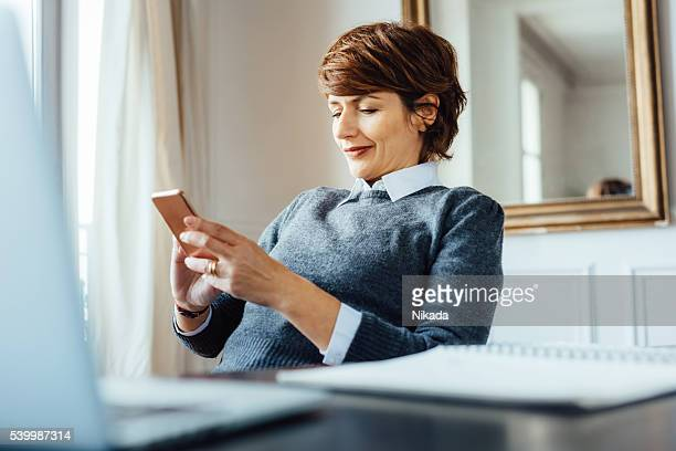 french businesswoman with mobile phone