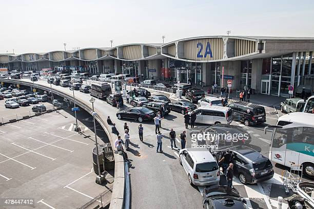 French cab drivers block the road outside Charles de Gaulle airport during a protest against Uber Technologies Inc's car sharing service in Roissy...