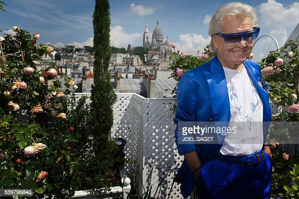 French cabaret director Michel Georges Alfred Catty also known as Michou poses on June 7 2016 in his house in Paris / AFP / JOEL SAGET
