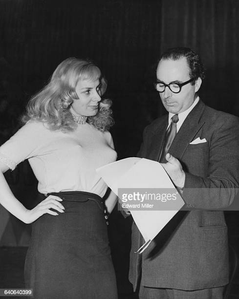French cabaret singer Danielle Lamar goes over the script for the television show 'MusicHall' with producer Richard Afton at Earl's Court in London...