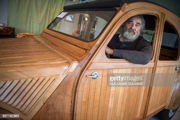 French cabinetmaker Michel Robillard poses in his handbuilt wooden 2CV Citroen Car built as an exact one/one replica on March 20 near Loches Central...