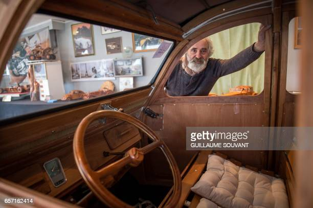 French cabinetmaker Michel Robillard poses with his handbuilt wooden 2CV Citroen Car built as an exact one/one replica on March 20 near Loches...