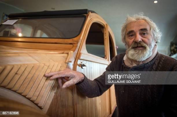 French cabinetmaker Michel Robillard shows details of his handbuilt wooden 2CV Citroen Car built as an exact one/one replica on March 20 near Loches...