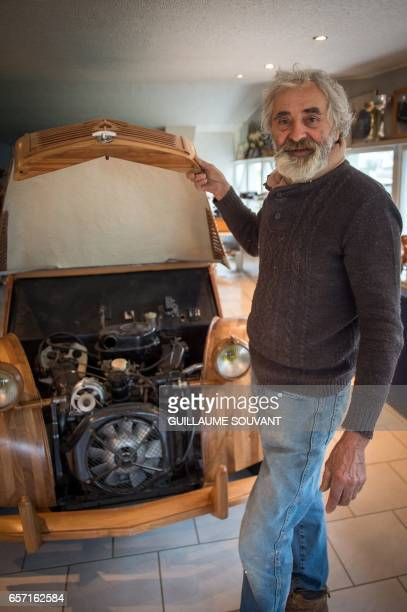 French cabinetmaker Michel Robillard shows the details of his handbuilt wooden 2CV Citroen Car built as an exact one/one replica on March 20 near...