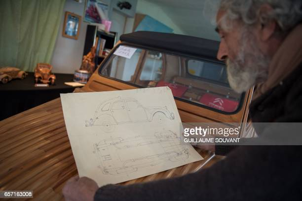 French cabinetmaker Michel Robillard shows the details plans for the building of a wooden 2CV Citroen Car built as an exact one/one replica on March...