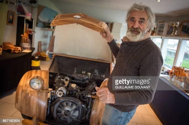 French cabinetmaker Michel Robillard shows the motor of his handbuilt wooden 2CV Citroen Car built as an exact one/one replica on March 20 near...