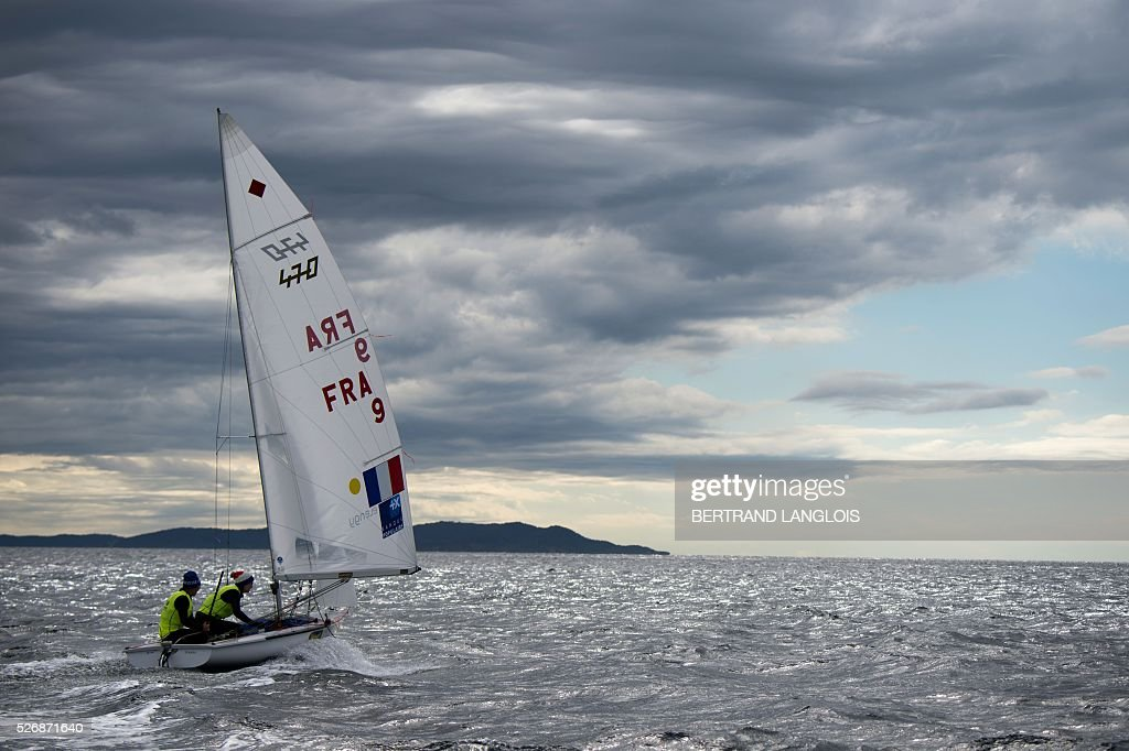 French Camille Lecointre and Helene Defrance take part in the Sailing World Cup round Women's 470 competition in Hyeres, southern France, on May 1, 2016. / AFP / BERTRAND